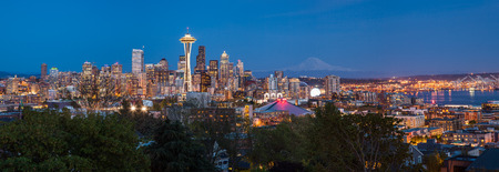 Panorama of Seattle downtown skyline and Mt. Rainier at night Washington.