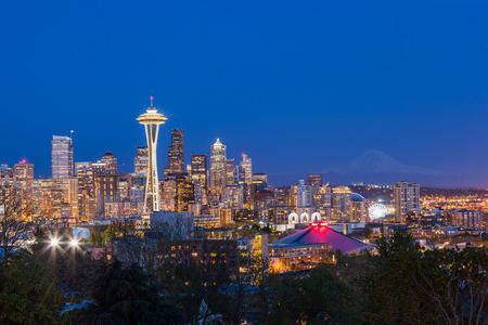MOUNT RAINIER: Seattle downtown skyline and Mt. Rainier at night Washington.