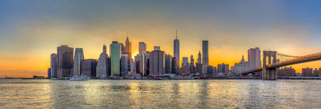 panorama city panorama: New York City downtown skyline and Brooklyn bridge at sunset