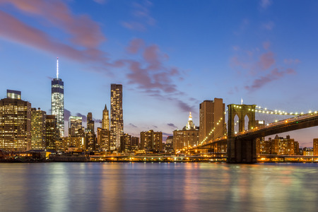 manhattan bridge: Brooklyn bridge and downtown New York City at night Stock Photo