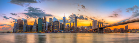 manhattan bridge: Brooklyn bridge and downtown New York City in beautiful sunset Stock Photo