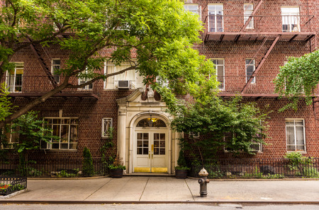 brick: Old brownstone apartment building in Manhattan, New york city