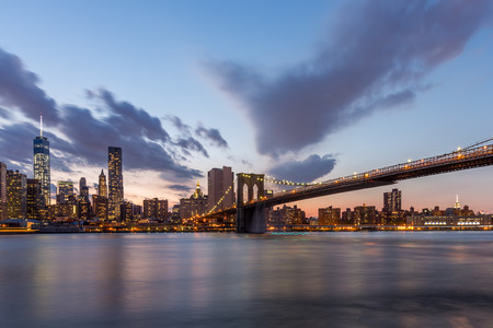 city park skyline: Brooklyn bridge and downtown New York City in beautiful sunset.