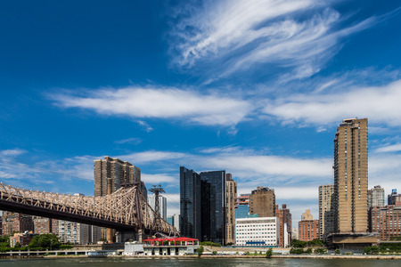 queensboro bridge: New york residential building by east river from roosevelt island Stock Photo