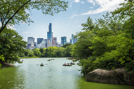 city park skyline: Lake in central park and New York city skyline Stock Photo
