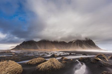 desert sand: Vesturhorn Mountain and black sand dunes, Iceland.