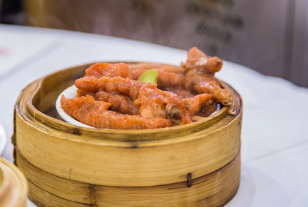 person appetizer: Chicken feet dimsum - Chinese food Stock Photo