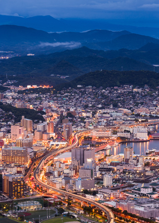 tollway: Sasebo cityscape at night, Nagasaki, Japan Stock Photo