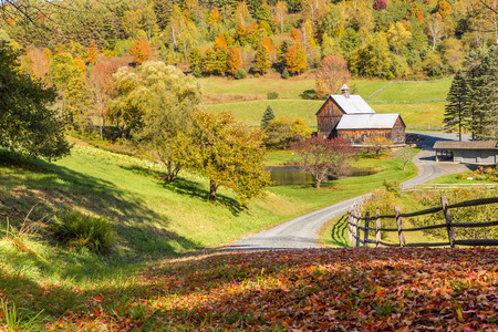 Old barn in beautiful Vermont autumn landscape.