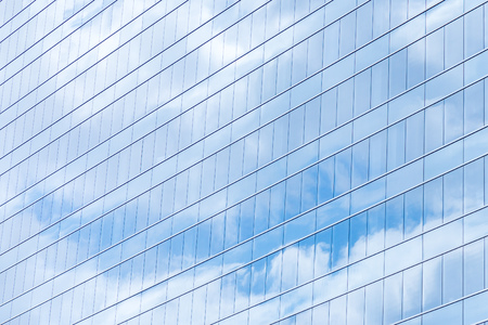 reflection: Modern building glass windows with sky reflection Stock Photo