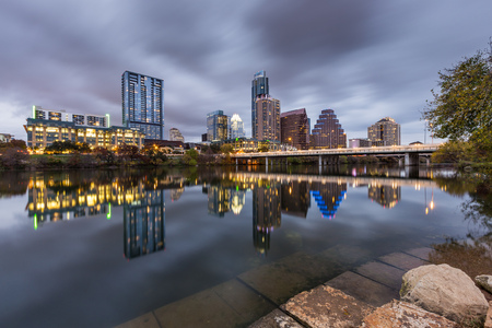 Austin downtown skyline by the river at night, Texas.