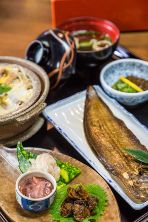 Luxurious Japanese meal set - broiled sole fish and boiled loaches with egg and burdock Stock Photo