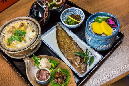 broiled: Luxurious Japanese meal set - broiled sole fish and boiled loaches with egg and burdock Stock Photo