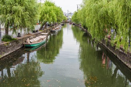 downstream: Traditional poled boat, parked at deck in Yanagawa, Fukuoka, Japan.