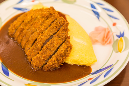 close up Japanese curry omurice with deep fired pork cutlet Stock Photo