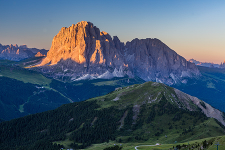Dolomite mountain landscape at sunrise from Seceda peak, Italy.