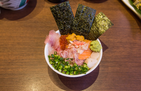 Mixed seafood donburi (rice bowl) with minced tuna, urchin and scallop. Stock Photo