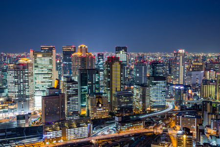 Osaka downtown skyline from Umeda sky building at night, Japan