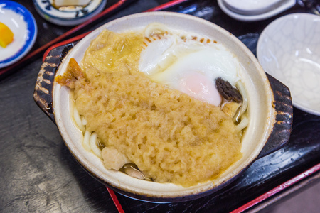 delicious shrimp tempura udon with egg -  Japanese food.