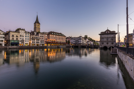 Beautiful view of old town zurich by Limmat river before sunrise, Switzerland Stock Photo