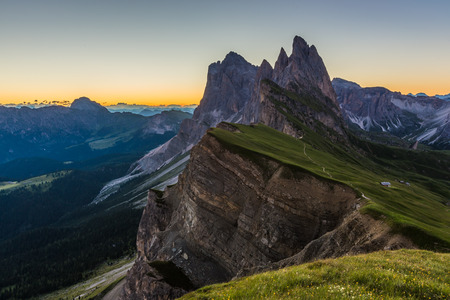 Beautiful sunrise and Odle Mountain landscape in Dolomites, Italy from Seceda peak Stock Photo
