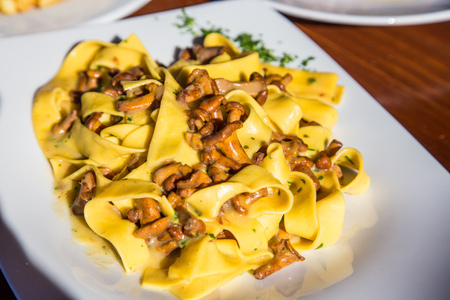 Fettuccine Alfredo with Mushrooms in restaurant Stock Photo
