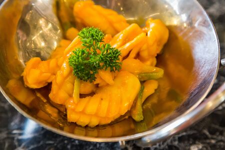 Close up stir fried squid with salted egg sauce Stock Photo