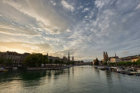 Historic Zurich downtown skyline with Fraumunster and Grossmunster churches at lake zurich during sunset, Switzerland.