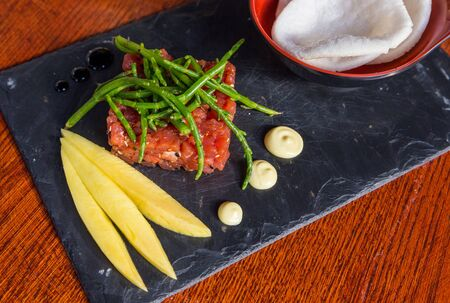 Tuna tataki - light grilled tuna in sesame seed coating served with citrus sauce and wasabi mayonnaise.