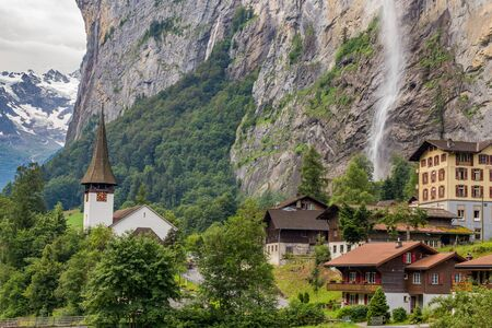 Amazing view of famous Lauterbrunnen town in Swiss Alps valley with beautiful Staubbach waterfalls in the background, Switzerland. Reklamní fotografie