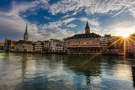 Beautiful view of Fraumunster Church and old town zurich by Limmat river before sunset, Switzerland