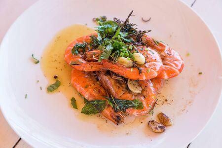 Thai food - spicy Shrimp salad with garlic and basil