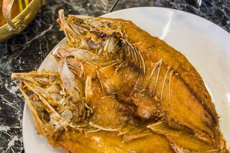 Close up deep fried whole sea bass with fish sauce