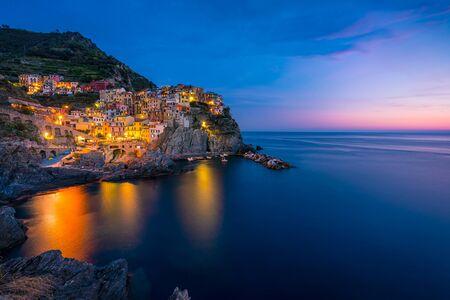 Colorful Manarola village in Cinque terre, Italy at night