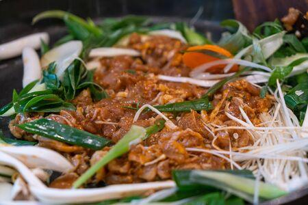 Dak galbi - Traditional Korean stir fried chicken with spicy sause.