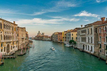 Famous view of Basilica di Santa Maria della Salute and grand canal from Accademia Bridge, Venice, Italy