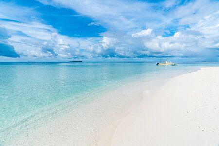 Paradise white sand beach and blue sky in sandbank island, Maldives