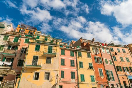 Traditional colorful building and houses in Riomaggiore, the fisherman village, in Cinque terre, Italy