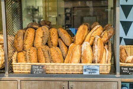 Loaves of Italian white Bread, Ciabatta, in bakery shop