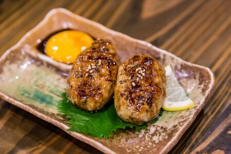 Traditional Japanese grilled chicken, Yakitori, with marinated egg yolk