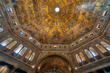 Florence, Italy - October 4, 2017 : Mosaic-covered interior of the octagonal dome in Baptistery of Saint John in Florence, Italy. Editorial