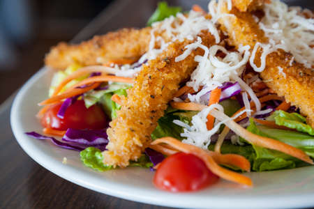 Fresh salad with crispy fried crab stick Imagens