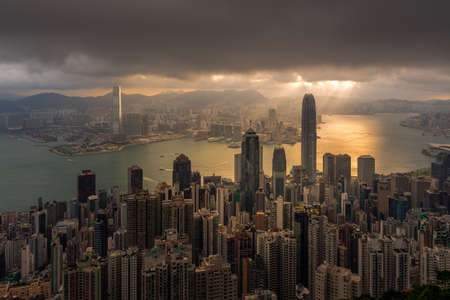 Hong Kong city skyline from Victoria peak, China with dramatic sky Stock Photo