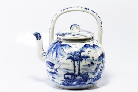facing right: Small blue willow pattern tea pot with spout facing left and handle facing right Stock Photo