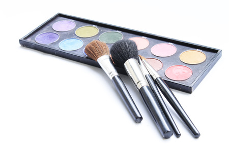 makeup brush and cosmetics, on a white background photo