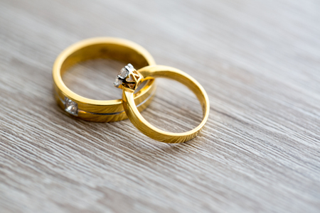 Diamond ring, wedding ring, Wedding Ring bride price. Wedding symbols. Wedding ceremony. image for objects and article.rings on wooden surface, symbol of couple Imagens