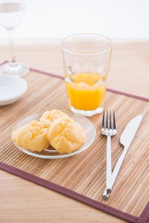 choux pastry and orange juice photo