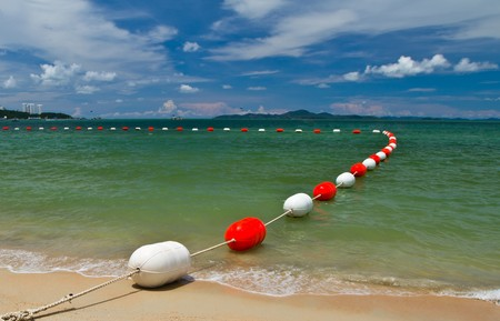 The buoys in safety area to protection for the swimmer Stock Photo - 7773897
