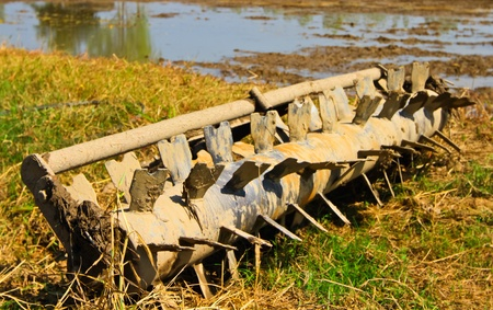 Part of agricultural tractor to plowing the rice field photo