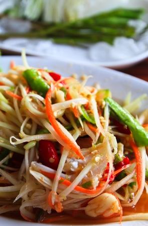 Papaya salad, North east cuisine. Thailand  photo